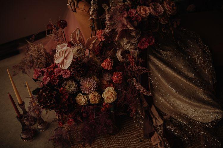 Pink wedding flower arrangement with dahlias and anthuriums