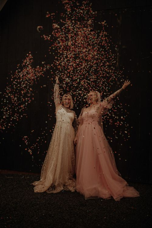 Confetti explosion with bride in pink dress for wedding inspiration at The Giraffe Shed