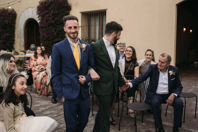 Outdoor Wedding Ceremony Groom Entrance in Forest Green Wedding Suit