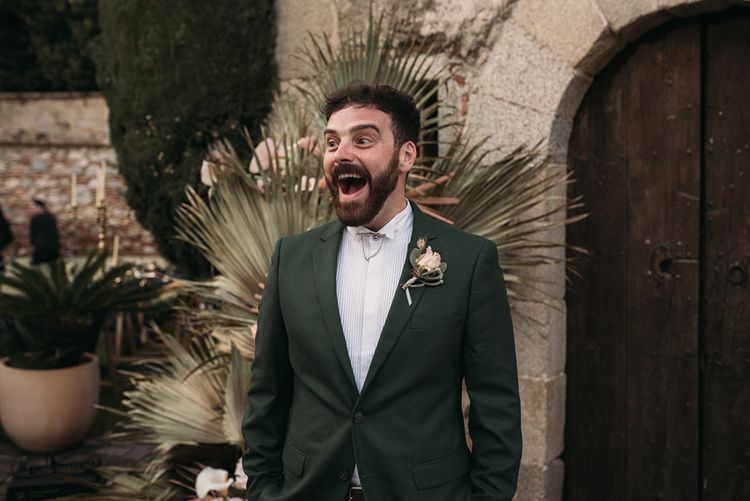 Surprised Groom at the Altar in a Forest Green Wedding Suit