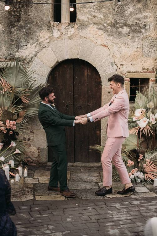 Same Sex Wedding Ceremony with Two Grooms in Green and Pink Wedding Suits