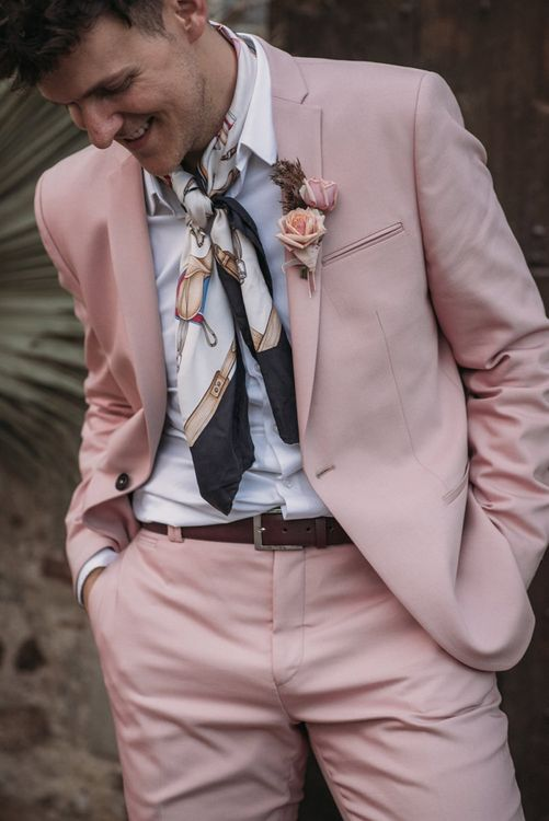 Groom in Blush Pink Wedding Suit with Neck Tie