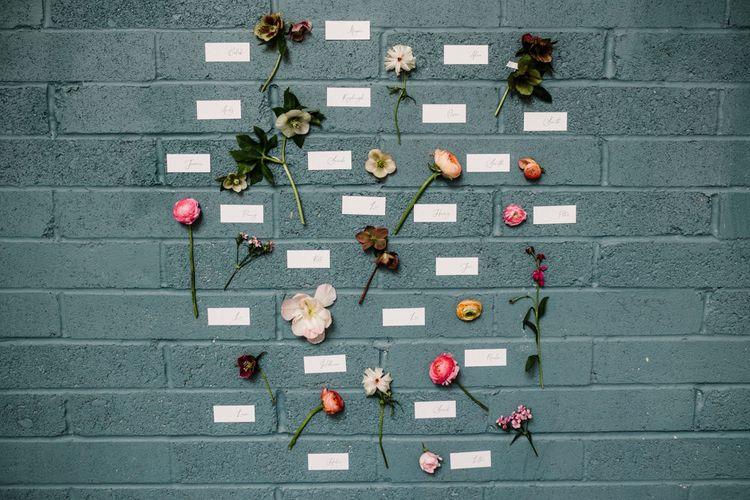 Escort Cards and Flower Stems Wedding Decor