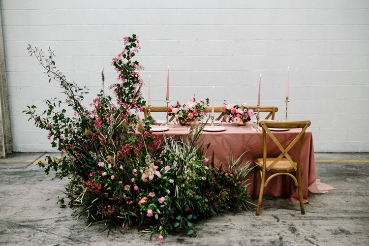Table Decor with Pink Table Cloth, Taper Candles and Large Floral Arrangement