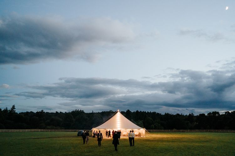 Marquee during dusk as the moon illuminates the sky at Hawarden Castle in Wales