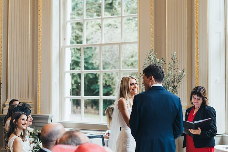Bride and Groom Exchanging Vows in Orleans House Gallery Ceremony