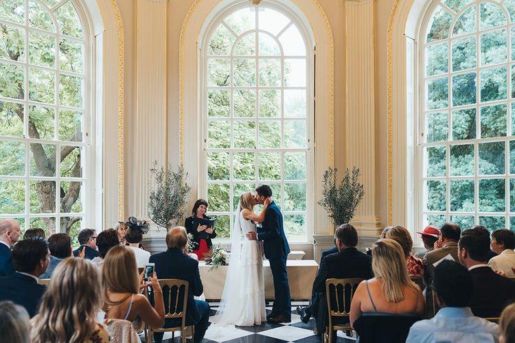 Bride and Groom Kiss in Orleans House Gallery Wedding Venue