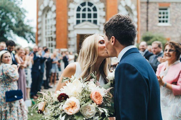 Bride Bouquet with Groom in Navy Suit
