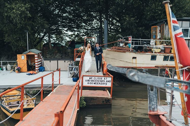 Bride and Groom Boarding Boat to Reception