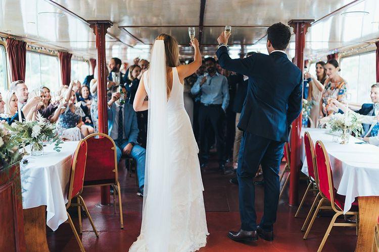 Bride and Groom Make Toast on Boat