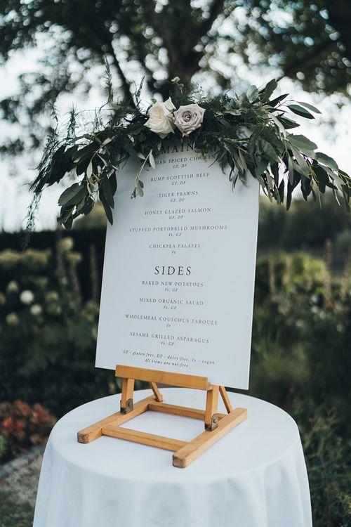Simple Wedding Menu Sign with Foliage Decor