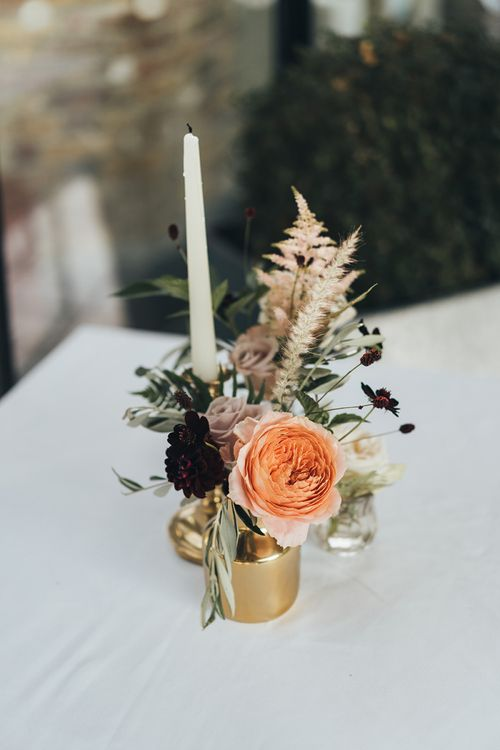 Simple Floral Centrepieces with Candle and Gold Highlights