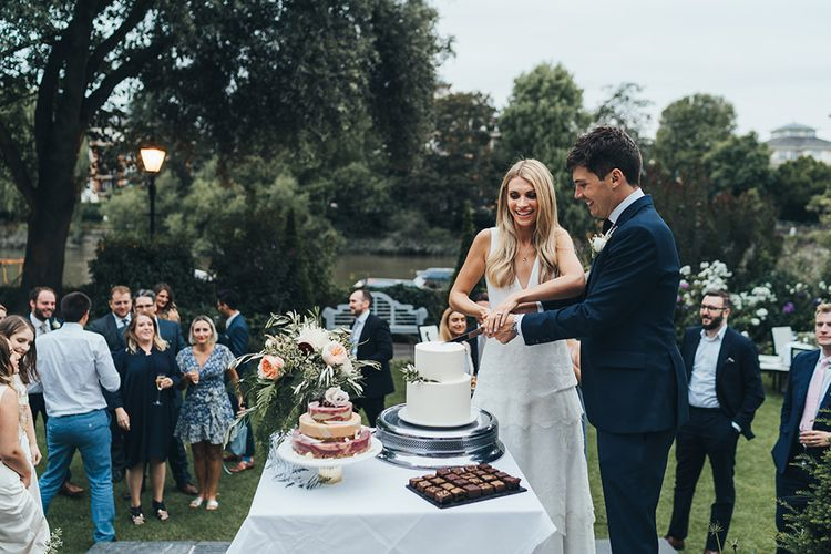 Bride and Groom Cutting Cake Portrait