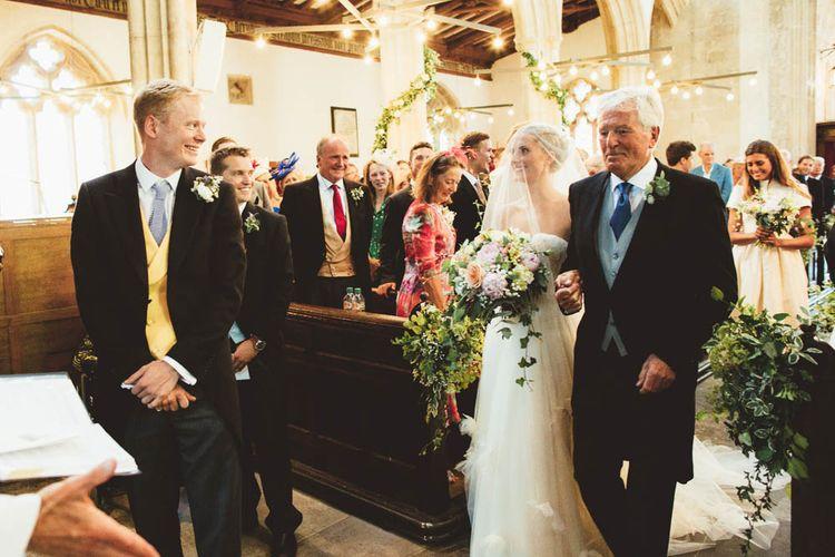Bride in Halfpenny London Wedding Dress meeting Her Groom at the Altar