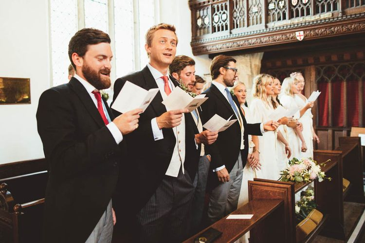 Groomsmen and Bridesmaids Singing During the Church Wedding Ceremony