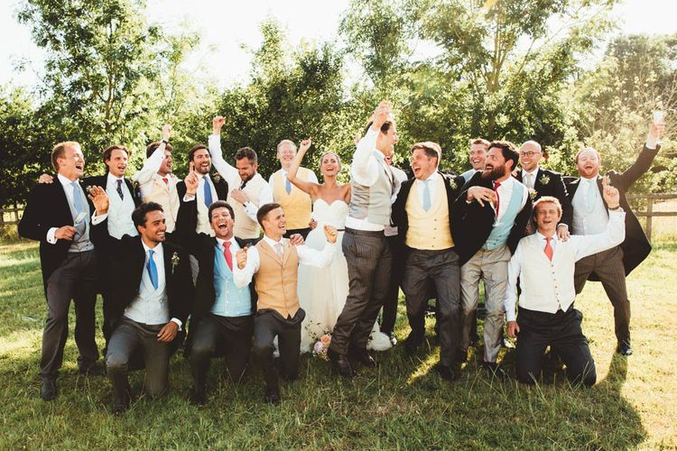 Bride in Halfpenny London Wedding Dress with Groomsmen in  Waistcoats and Tails