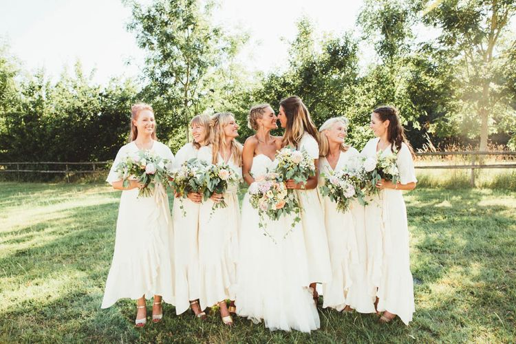 Bridal Party in White Dresses and Bride in HalfPenny London Wedding Dress