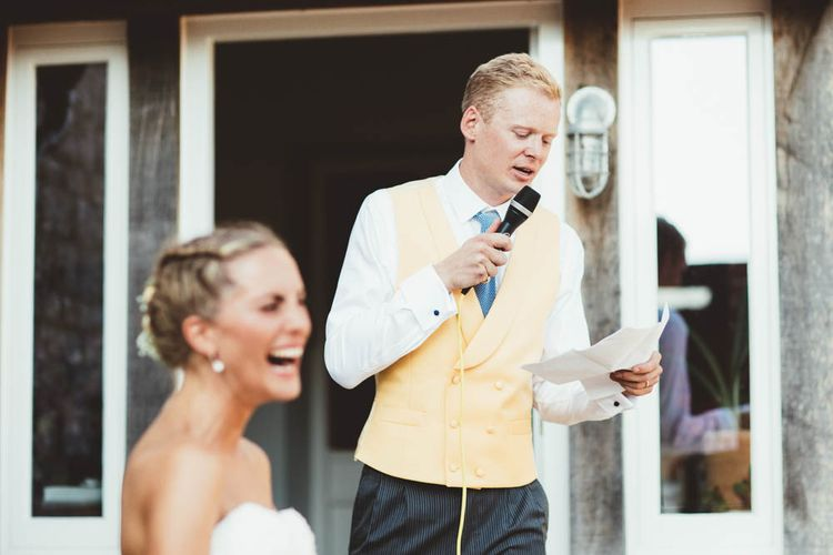 Groom in Yellow Waistcoat and Blue Tie Giving His Wedding Speech