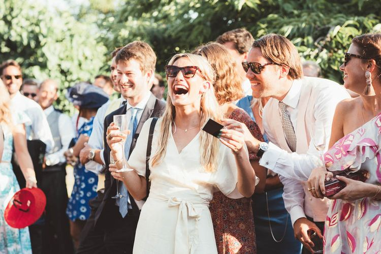 Wedding Guests Laughing During Wedding Speeches