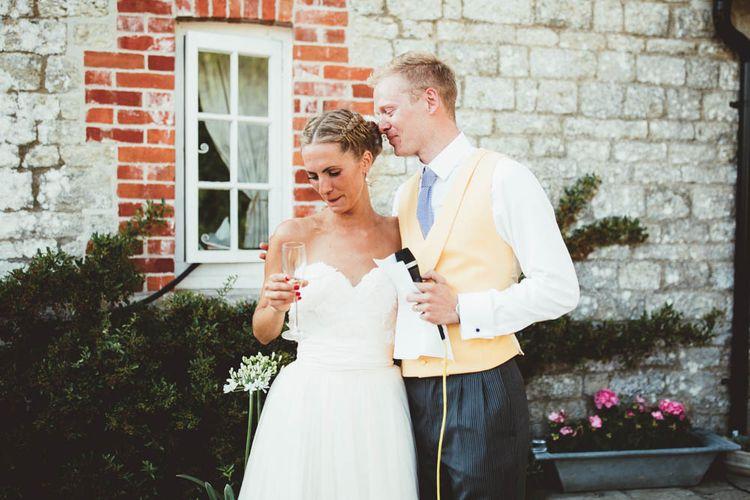 Bride and Groom Hugging During Wedding Speech