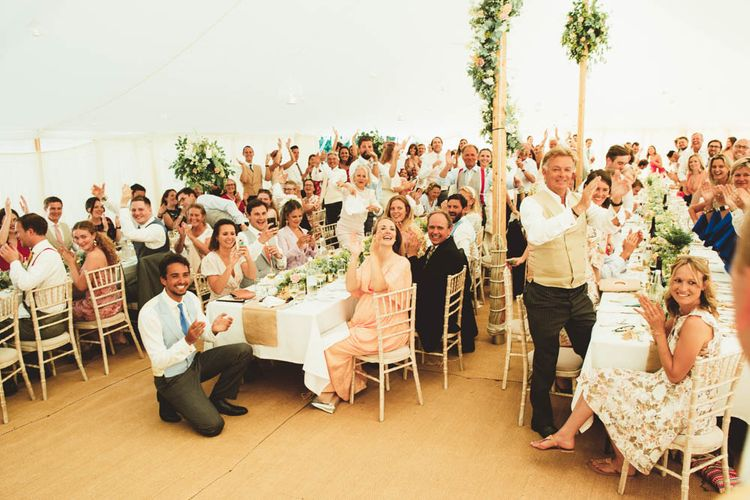 Wedding Guests Clapping in Marquee Wedding Reception