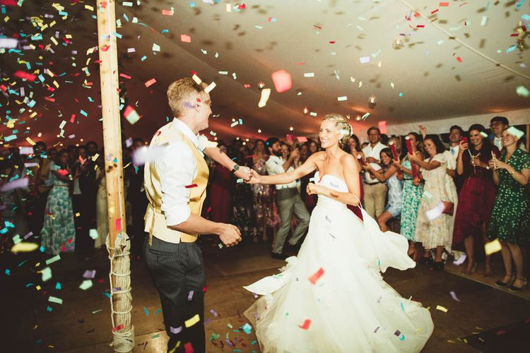 Confetti Bomb Dance Floor Moment with Bride in Halfpenny London Wedding Dress and Groom in Yellow Waistcoat