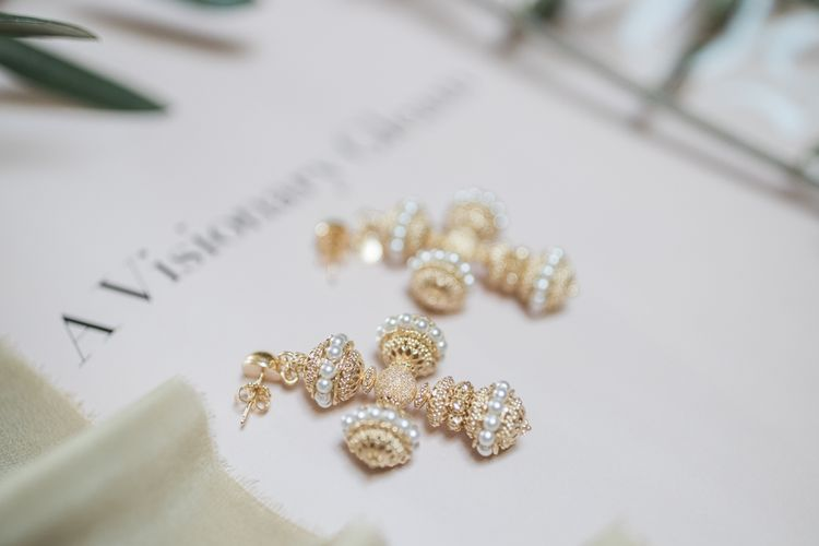 Gold and pearl crusafix earrings