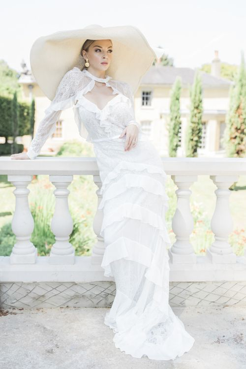 Bride in lace and ruffle wedding dress with star hat for Italian micro themed wedding