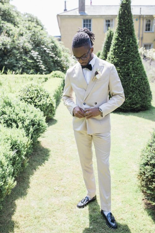 Groom in beige suit at The Old Rectory Estate Italian micro themed wedding