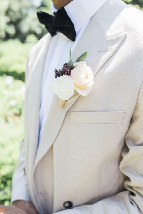White and peach floral buttonhole fir Italian themed micro wedding