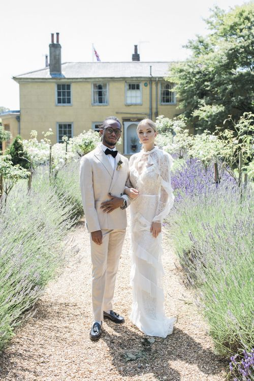 Bride and groom standing in the gardens at The Old Rectory Estate for an Italian themed micro wedding