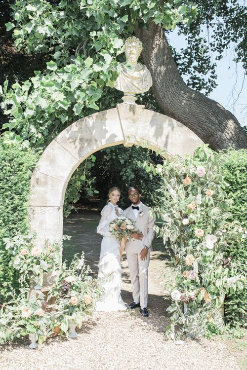 Italian themed micro wedding with bride in ruffle dress and groom in a beige suit