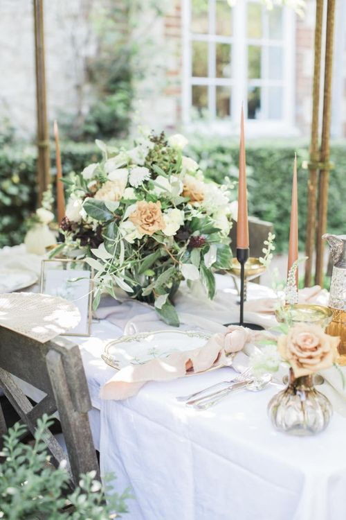 Italian themed micro wedding  tablescape  with candles and flowers