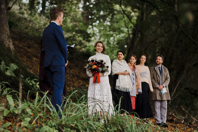 Boho Bride in Crochet Wedding Dress and Woollen Jumper  Saying I Do in a Woodland Forest