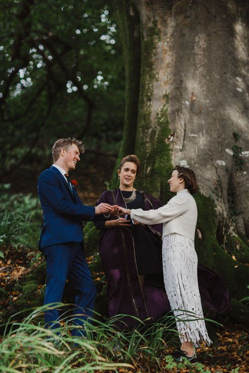 Bride and Groom Saying Their Vows During a Woodland Ceremony