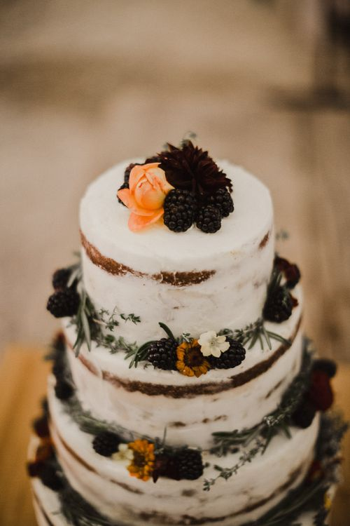 Semi Naked Wedding Cake with Blackberries and Edible Flower Decoration