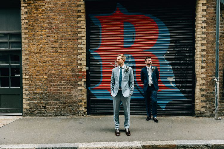 Pre-Ceremony Photos in Shoreditch | Groom in Dark Petrol Blue Suit by Paul Smith | Groom in Light Blue Made-To-Measure Suit by Beggars Run | Dark Brown Russell & Bromley Shoes | Brown Aldo Shoes | Same Sex Wedding with Industrial Styling at Wimborne House | Marmelo Photography