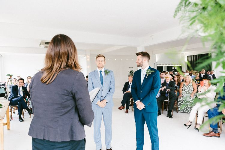 Wedding Ceremony | Groom in Dark Petrol Blue Suit by Paul Smith | Groom in Light Blue Made-To-Measure Suit by Beggars Run | Same Sex Wedding with Industrial Styling at Wimborne House | Marmelo Photography