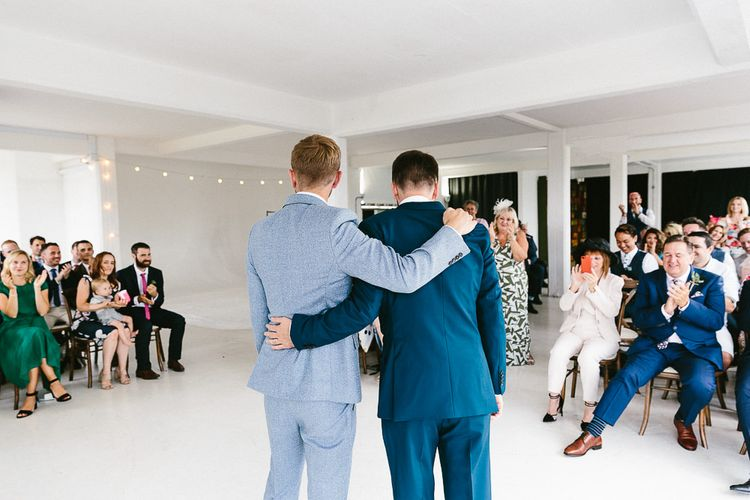 Wedding Ceremony | Just Married | Festoon Lights | Groom in Dark Petrol Blue Suit by Paul Smith | Groom in Light Blue Made-To-Measure Suit by Beggars Run | Same Sex Wedding with Industrial Styling at Wimborne House | Marmelo Photography