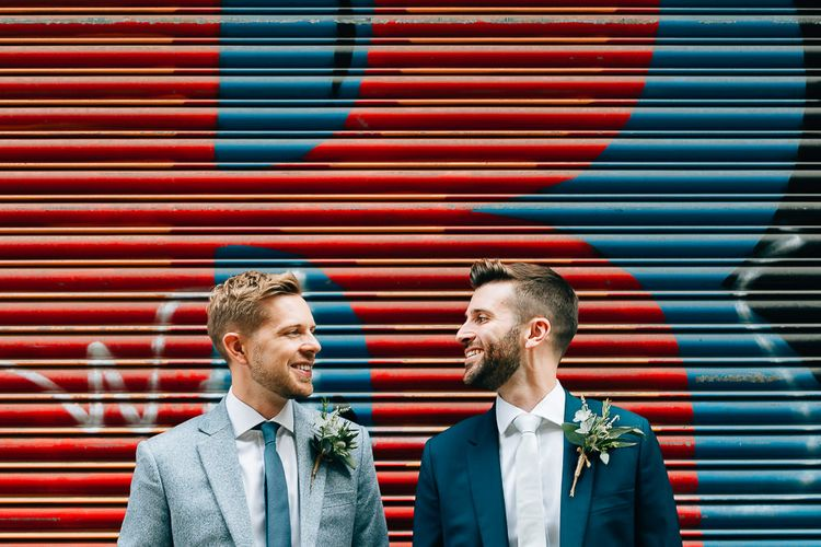 Pre-Ceremony Photos in Shoreditch | Groom in Dark Petrol Blue Suit by Paul Smith | Groom in Light Blue Made-To-Measure Suit by Beggars Run | Same Sex Wedding with Industrial Styling at Wimborne House | Marmelo Photography