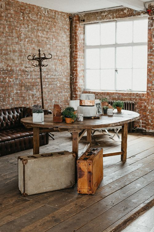 Wedding Reception Decor | Marble Wedding Cake with Copper Leaf | Potted Plants | Vintage Suitcases | Coat Stand | Same Sex Wedding with Industrial Styling at Wimborne House | Marmelo Photography