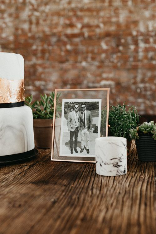 Wedding Reception Decor | Marble Wedding Cake with Copper Leaf | Photo in Copper Frame | Potted Plants | Succulents | Same Sex Wedding with Industrial Styling at Wimborne House | Marmelo Photography