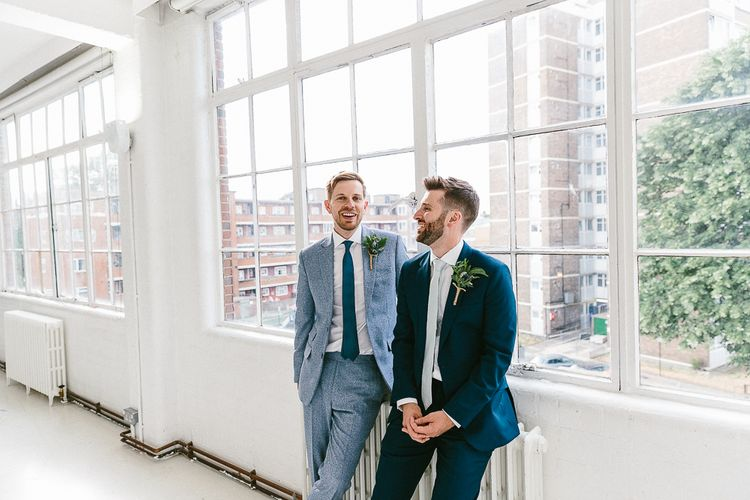 Groom in Dark Petrol Blue Suit by Paul Smith | Groom in Light Blue Made-To-Measure Suit by Beggars Run | Huge Warehouse Windows | Same Sex Wedding with Industrial Styling at Wimborne House | Marmelo Photography