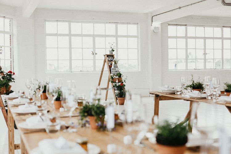 Wedding Reception Decor | Trestle Tables | Huge Warehouse Windows | Whitewashed Walls | Industrial Ladder with Potted Plants | Same Sex Wedding with Industrial Styling at Wimborne House | Marmelo Photography