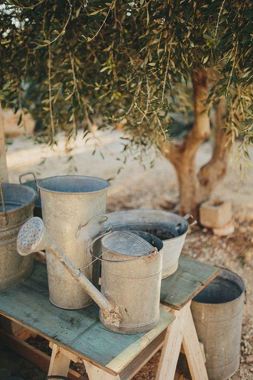 Watering Cans | Brightly Coloured Destination Wedding at Masseria Potenti Wedding Venue, Puglia, South Italy | Petar Jurica Photography | Marco Odorino Film