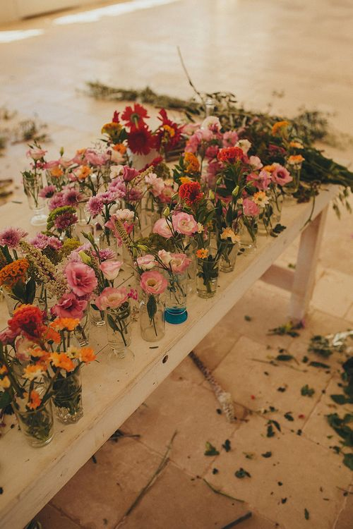 Wedding Flower Stems in Vases | Brightly Coloured Destination Wedding at Masseria Potenti Wedding Venue, Puglia, South Italy | Petar Jurica Photography | Marco Odorino Film