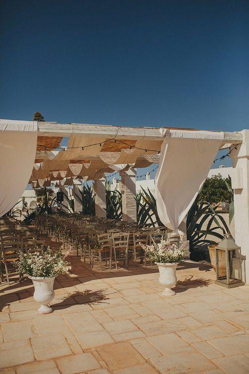Outdoor Aisle & Altar Style | Brightly Coloured Destination Wedding at Masseria Potenti Wedding Venue, Puglia, South Italy | Petar Jurica Photography | Marco Odorino Film