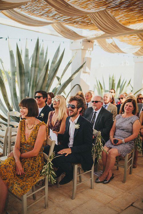 Outdoor Wedding Ceremony | Wedding Guests | Brightly Coloured Destination Wedding at Masseria Potenti Wedding Venue, Puglia, South Italy | Petar Jurica Photography | Marco Odorino Film