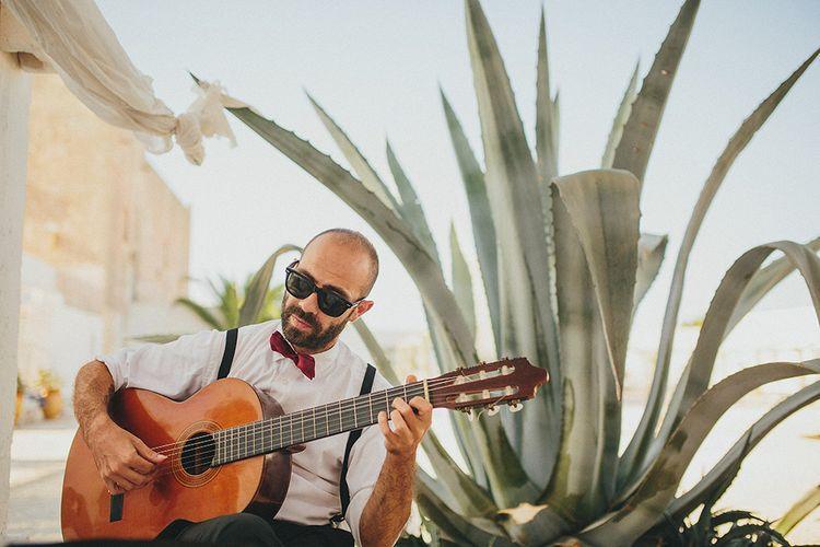 Outdoor Wedding Ceremony | Guitarist | Brightly Coloured Destination Wedding at Masseria Potenti Wedding Venue, Puglia, South Italy | Petar Jurica Photography | Marco Odorino Film