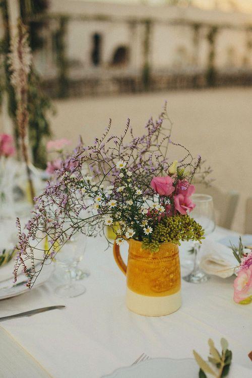 Wild Flowers in Pitcher Jug | Wedding Decor | Brightly Coloured Destination Wedding at Masseria Potenti Wedding Venue, Puglia, South Italy | Petar Jurica Photography | Marco Odorino Film